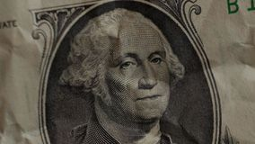 A hand-held dollar bills closeup. A hand-held one dollar bills closeup stock footage
