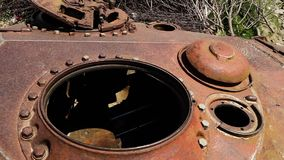 The narrow entrance in a tank. A hand held, extreme close up shot of the narrow rusty entrance to an abandoned tank stock footage