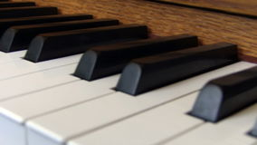 Hand-held Flyby Over Upright Piano Keyboard stock video footage