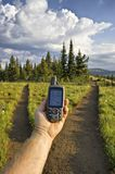 Hand-held GPS Unit At Trail Fork Stock Image