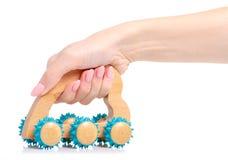 Hand-held massager in hand stock photos