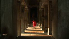 Monk walking alone in the temple