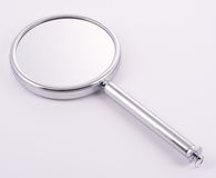 Hand Held Mirror with handle. Mirror for the handbag, luxury goods Stock Photo