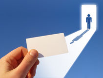 Hand-held note and silhouetted figure Stock Image