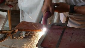 Hand held plasma cutter. Close up industrial stock footage