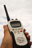 Hand held radio. Marine hand held radio against a sky background Royalty Free Stock Images