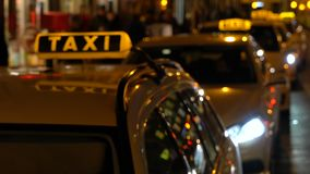 Hand held soft focus night time video of taxis and people in Berlin, Germany. Hand held soft focus night time video of taxis and people in Rosenthaler Strasse stock footage