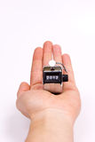 Hand held tally counter. Hand clicker counter at 2012 Stock Photo