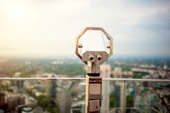 Hand held telescope on top of skyscraper at observation deck Stock Photo
