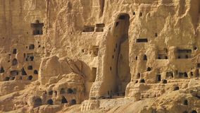 A temple in the hill. A hand held, wide shot  of a temple carved in a high, argil hill, in the desert stock video