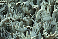 Hand from hell statue, Wat Rong Khun,Chiang Rai,Thailand. Stock Photos
