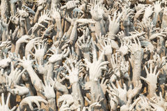 Hand from hell suffering. Conceptual sculpture representing hand from hell suffering, asking for help at Rongkhun Temple, Chiangrai Royalty Free Stock Photo