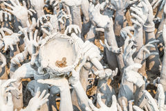 Hand from hell suffering. Conceptual sculpture representing hand from hell suffering, asking for help at Rongkhun Temple, Chiangrai Stock Images