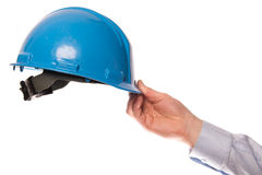 Hand with a helmet Stock Images