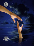 Hand help other who drowned in the water Royalty Free Stock Images