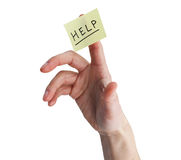 Hand With Help On Yellow Note Stock Photography