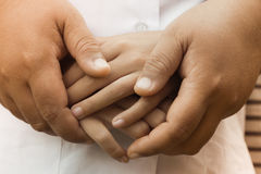Hand are helping  Mother and Child.  Stock Images