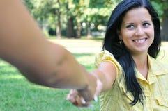 hand helping receiveing woman young Royaltyfri Fotografi