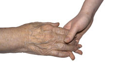 Hand of her grandmother and granddaughter. On a white background Stock Photography