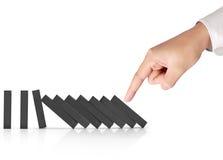 Hand het duwen domino'sconcept Stock Fotografie