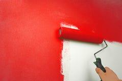 Hand het schilderen muur stock foto