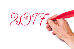 2017 Hand het schrijven aantallen rode veer op witte achtergrond Stock Afbeelding