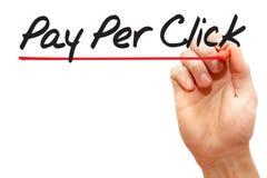 Hand het schrijven betaalt per Klik, bedrijfsconcept stock fotografie