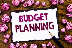 Hand het schrijven de inspiratie die van de teksttitel Begroting Planning tonen Bedrijfsconcept voor het Financiële In de begroti Stock Afbeeldingen