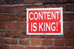 Hand het schrijven de inspiratie die van de teksttitel Inhoud tonen is Koningsconcept die Zaken betekenen Op de markt brengend On stock afbeeldingen