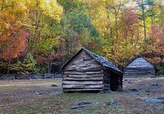 Hand hewd log barns surrounded by fall colors Stock Photography