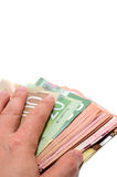 Hand hiding the stash of Canadian bank notes Royalty Free Stock Images