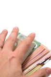Hand hiding the stash of Canadian banknotes. On white background Royalty Free Stock Photo