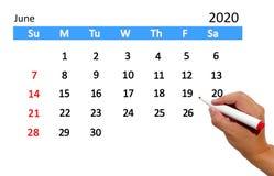 Hand highlighting date on calendar royalty free stock photo