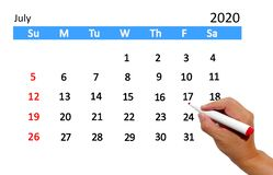 Hand highlighting date on calendar royalty free stock photos