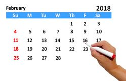 Highlighting date on calendar. Hand highlighting date on calendar Royalty Free Stock Image