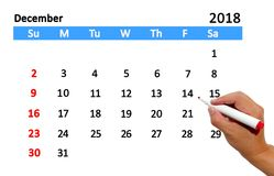 Highlighting date on calendar. Hand highlighting date on calendar Stock Photo