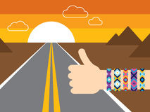 Hand with hippy friendship bracelets hitchhiking Royalty Free Stock Photos