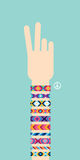 Hand with hippy friendship bracelets. Victory sign Stock Image