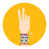 Hand with hippy friendship bracelets. Victory sign Stock Photos