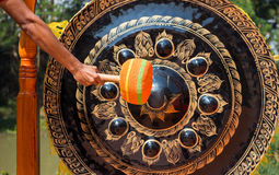 Hand hit gong. Royalty Free Stock Image