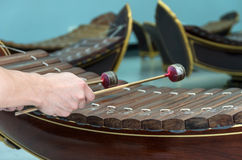 Hand hitting the Thai musical instrument (xylophone),asian instr Royalty Free Stock Image