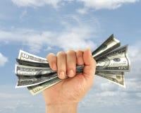 Hand hält Dollar an Stockfotos