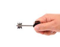 Hand hält modernen Stahlplastikschlüssel. Lizenzfreie Stockbilder