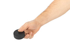Hand with hockey puck Royalty Free Stock Images