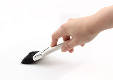 A hand hoding paint brush Stock Photography