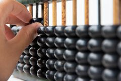 Hand hold abacus Stock Images