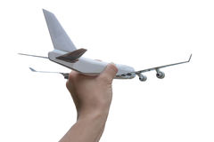 Hand hold airplane on background Stock Images