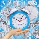 Hand hold alarm clock Stock Images