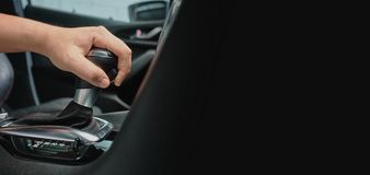 Hand hold automatic transmission car lever. Driving automobile with automatic gears and copy space for text royalty free stock photo