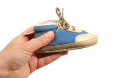 Hand hold baby shoe. On white background Stock Photos